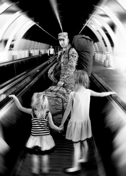 "Amanda captures a moment. Two little girls saying ""good-bye"" to their daddy as he departs for a deployment. This one chokes me up every time I see it."