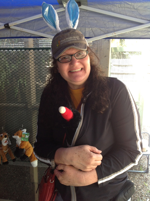 One of the volunteers, absolutely ecstatic to purchase a turkey vulture plush.