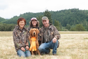 Success! Kinta earns his first JH qualifier. L-R: Noriko, Mary, Tim - Kinta with his ribbon.